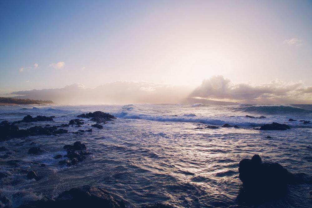 landscape photo of ocean waves crashing rocks