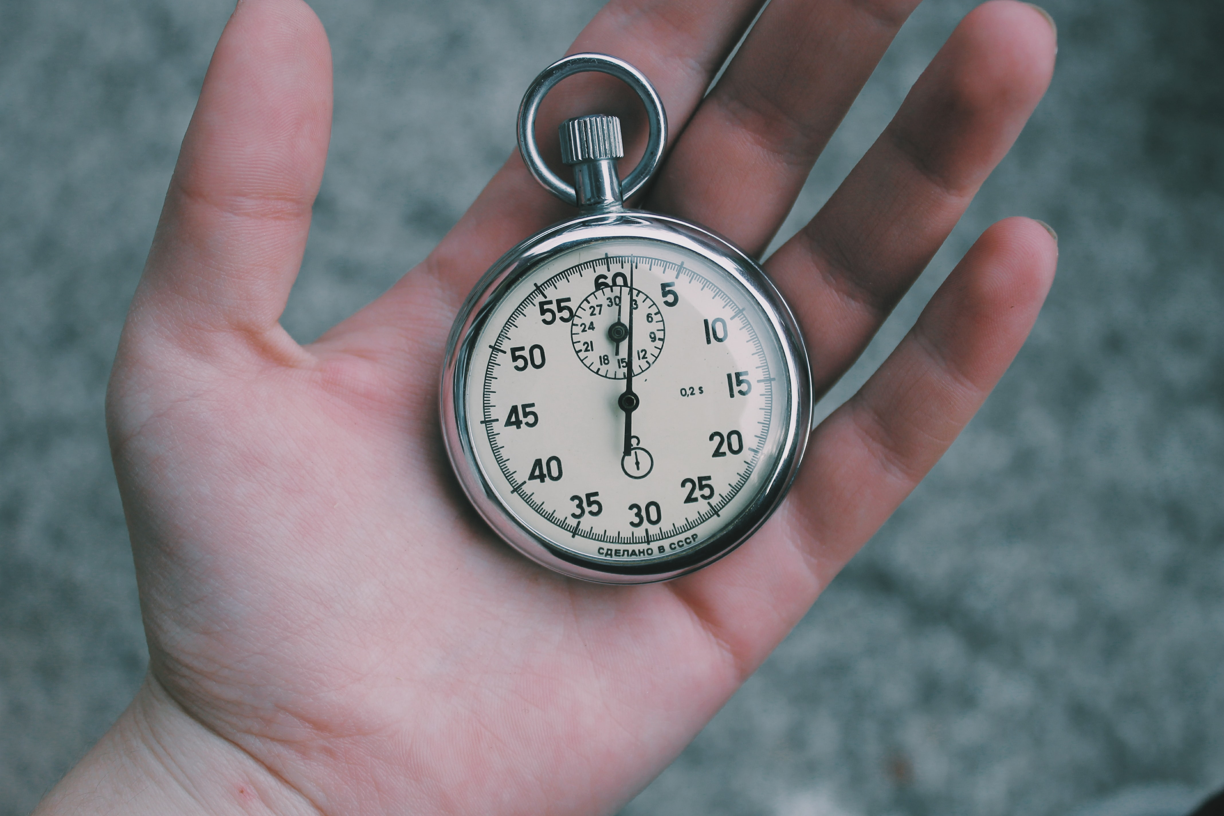 A pocket watch in a person's open hand