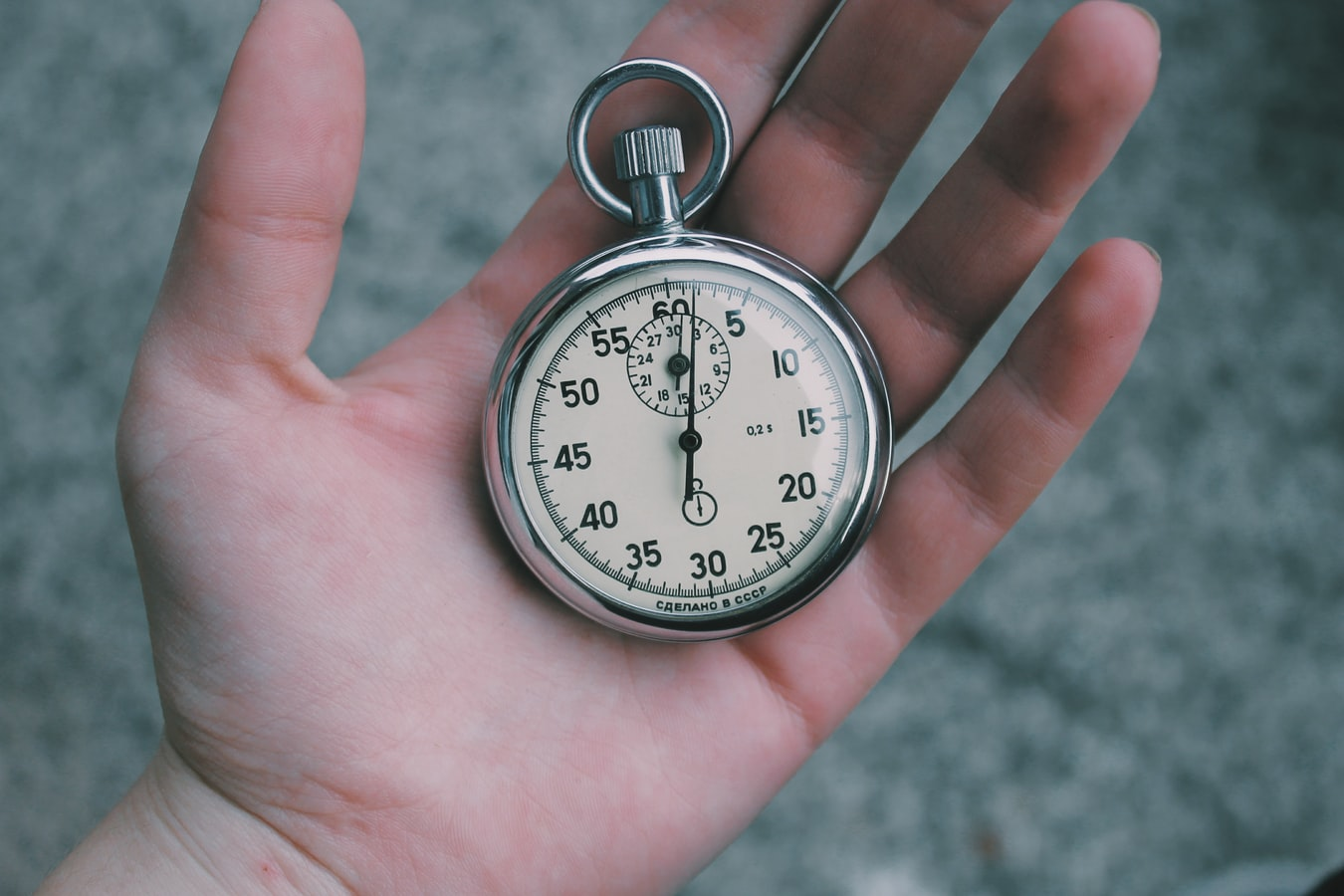 Hand holding a stopwatch