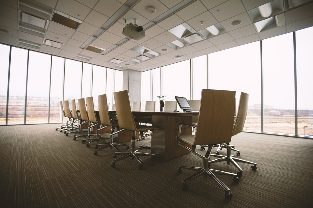 An empty boardroom with glass-to-ceiling windows