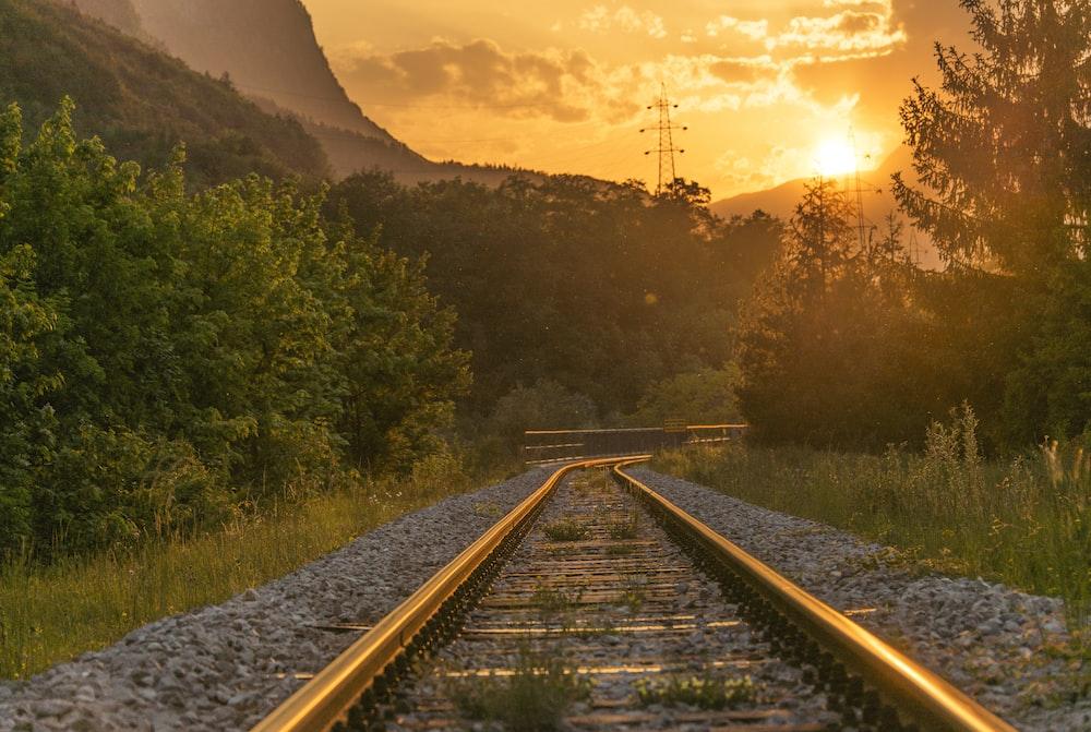 brown railway during sunset