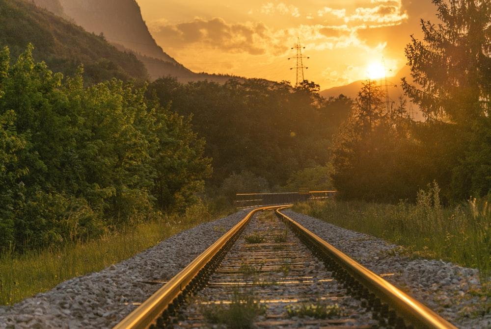 brown railway during sunset