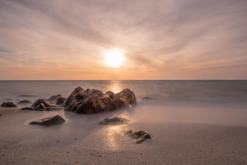 photo of rock in seashore