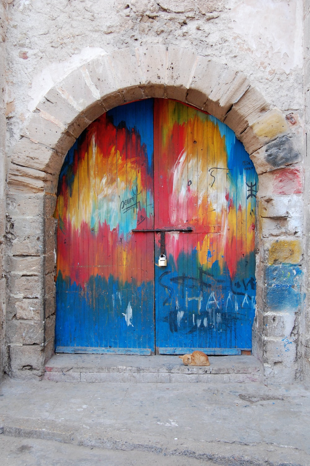 A colorfully painted rounded door.