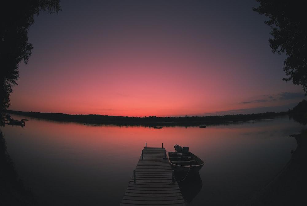 canoe on dock at night