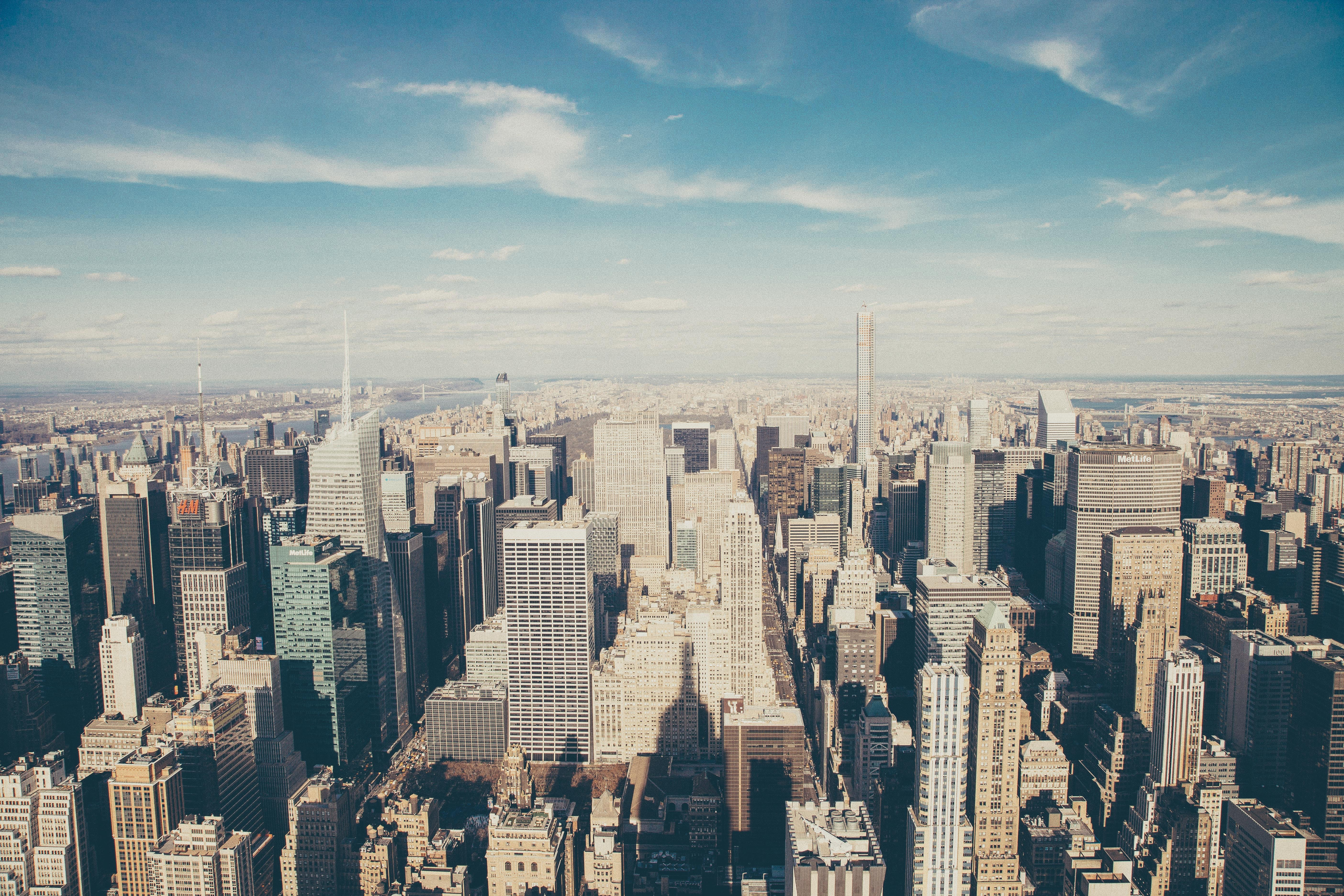 The New York City skyline on a bright day with a beautiful blue sky