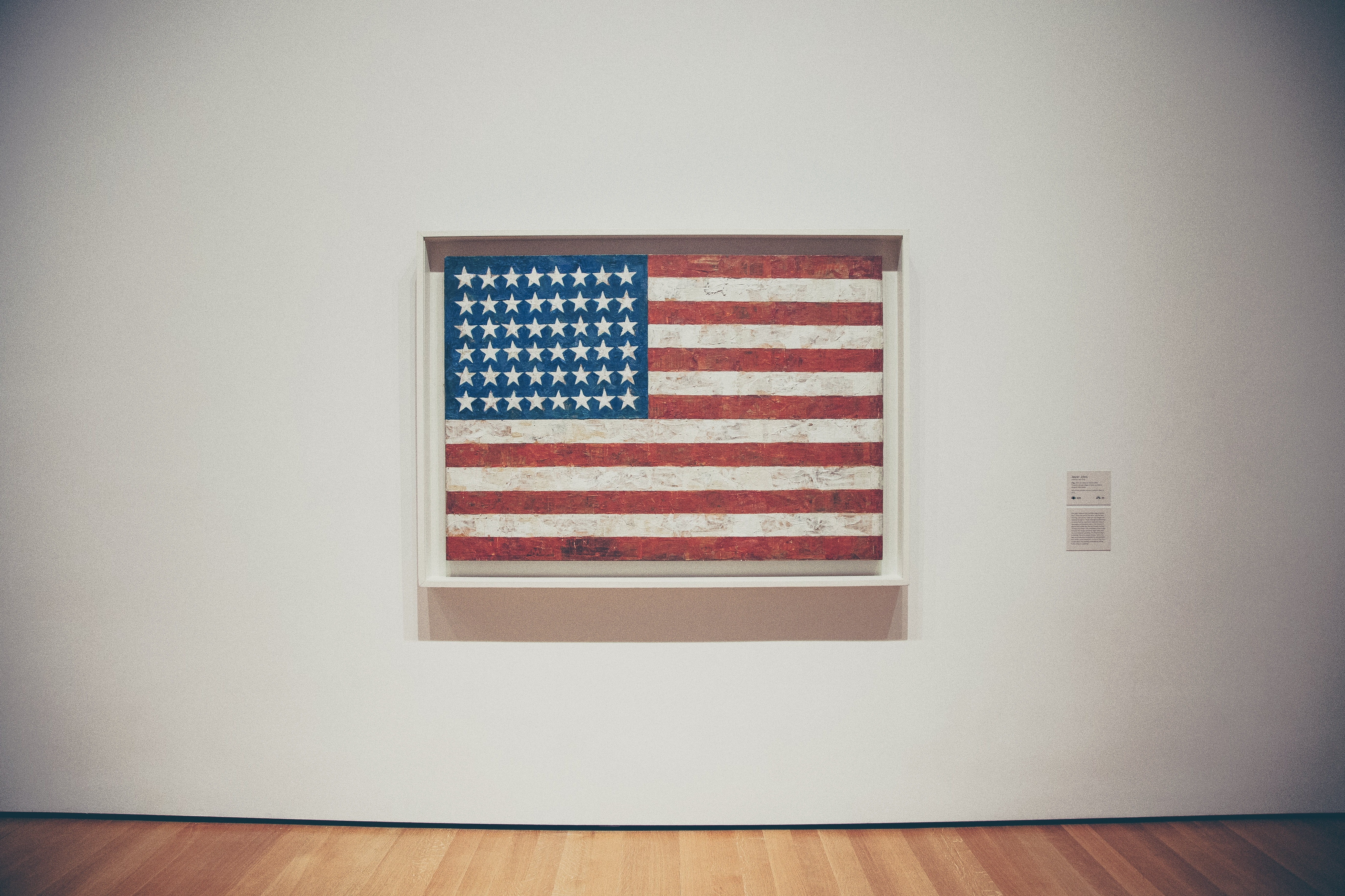 An American Flag painting on a wall in a museum