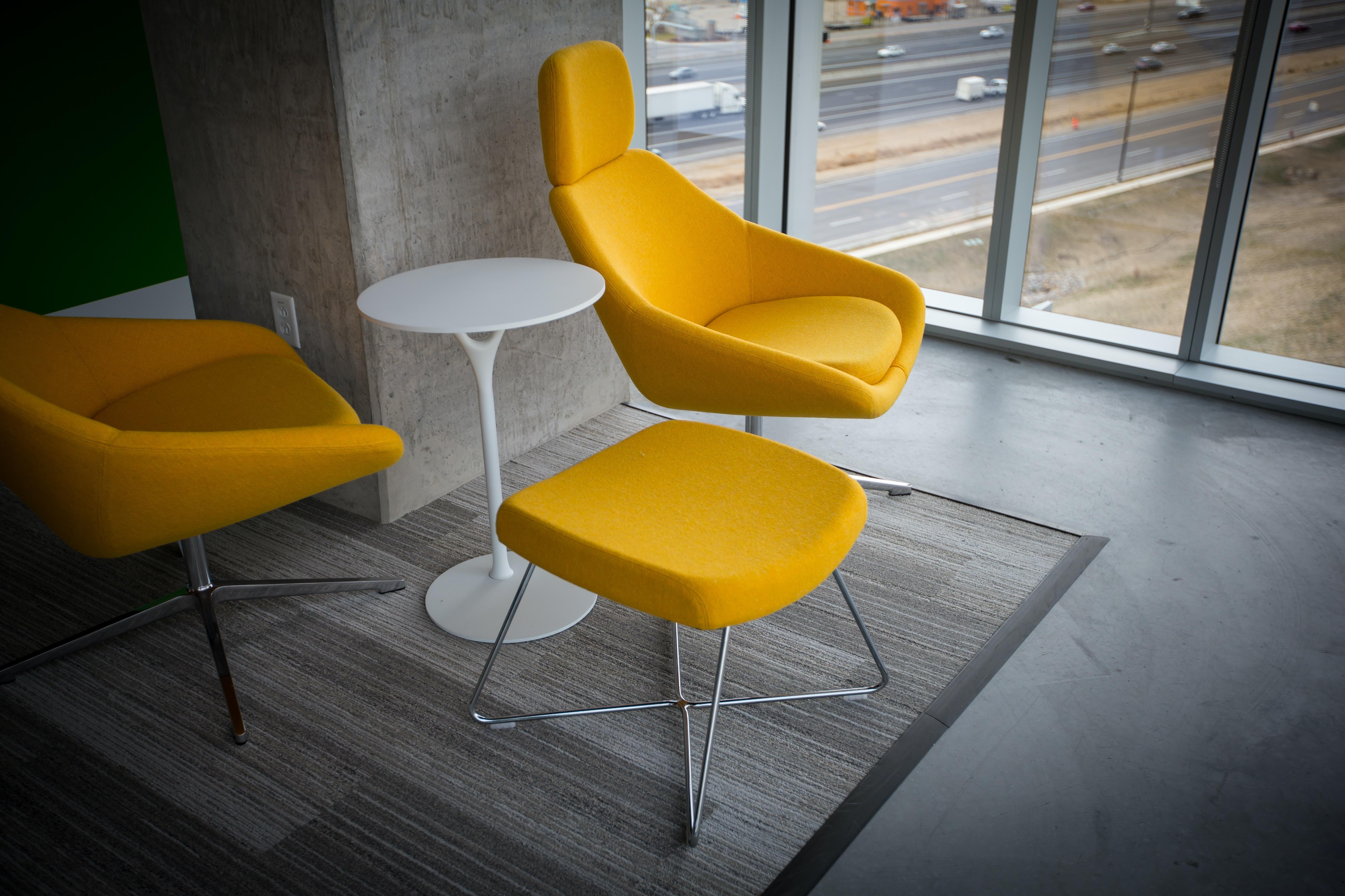 Postmodern-style yellow chairs.