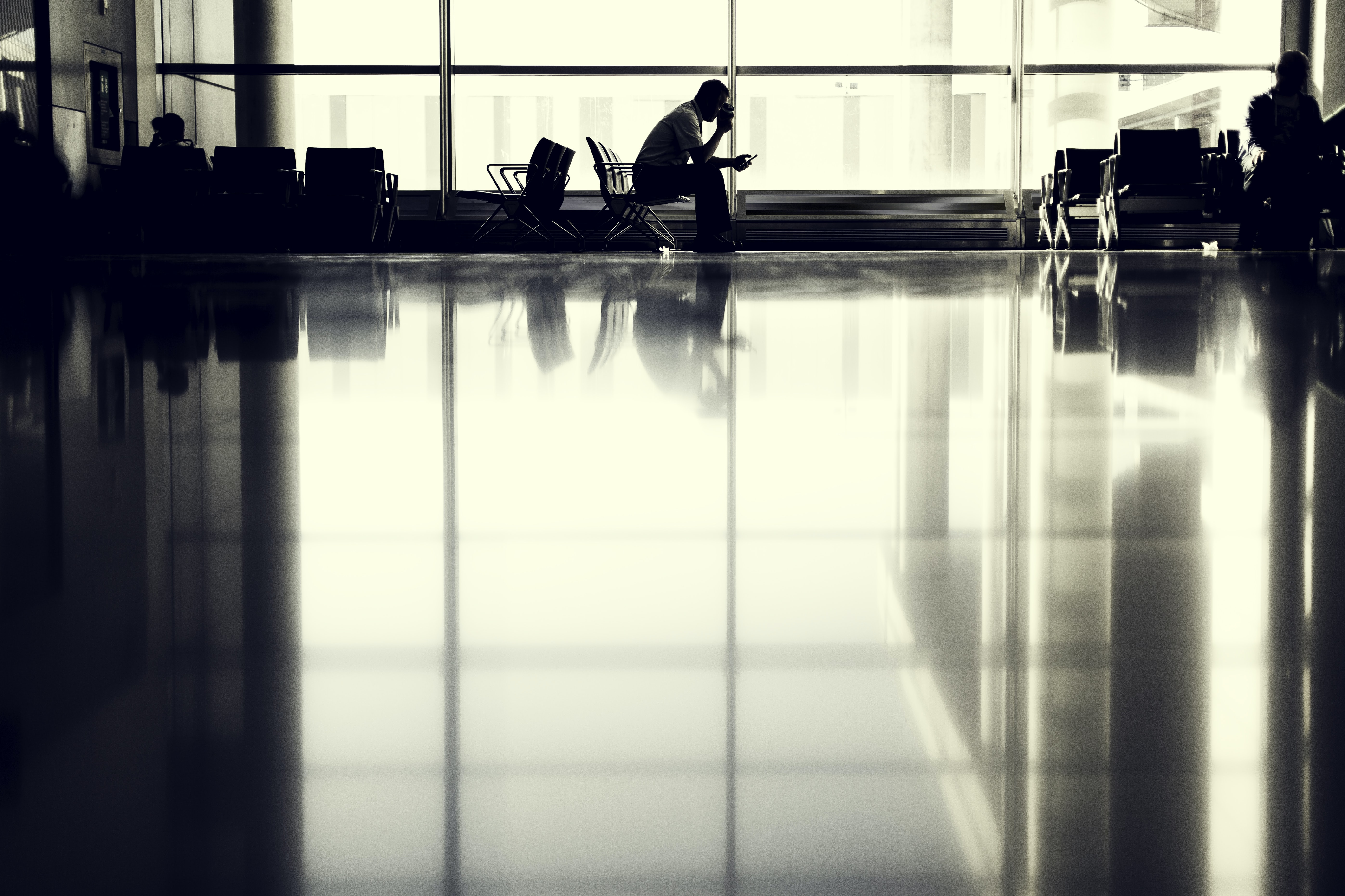 A man waiting in a chair at the airport