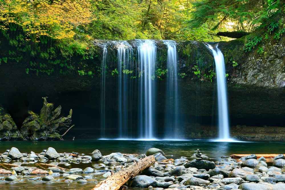 long-exposure photo of lake with waterfall at daytime