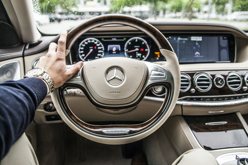person sitting in Mercedes-Benz driver seat