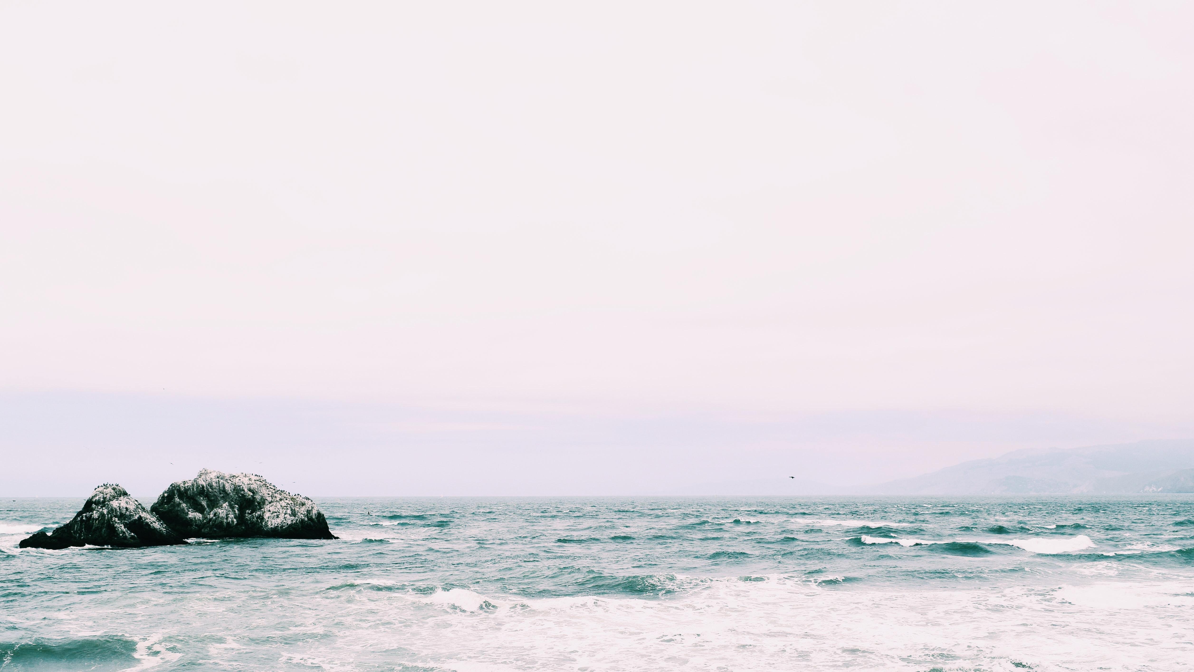 wavy sea under white sky