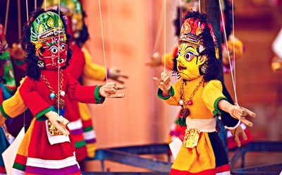 selective focus photography of deity marionettes