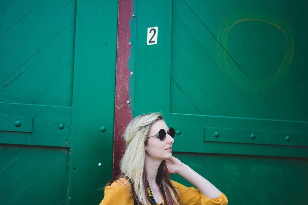 woman leaning on door