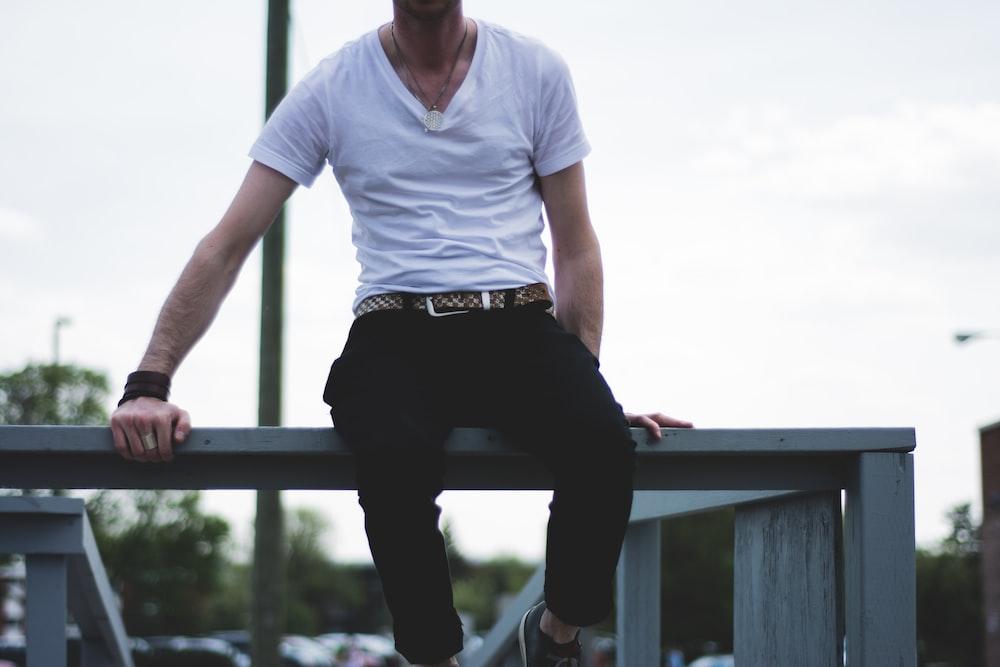 man sitting on balustrade