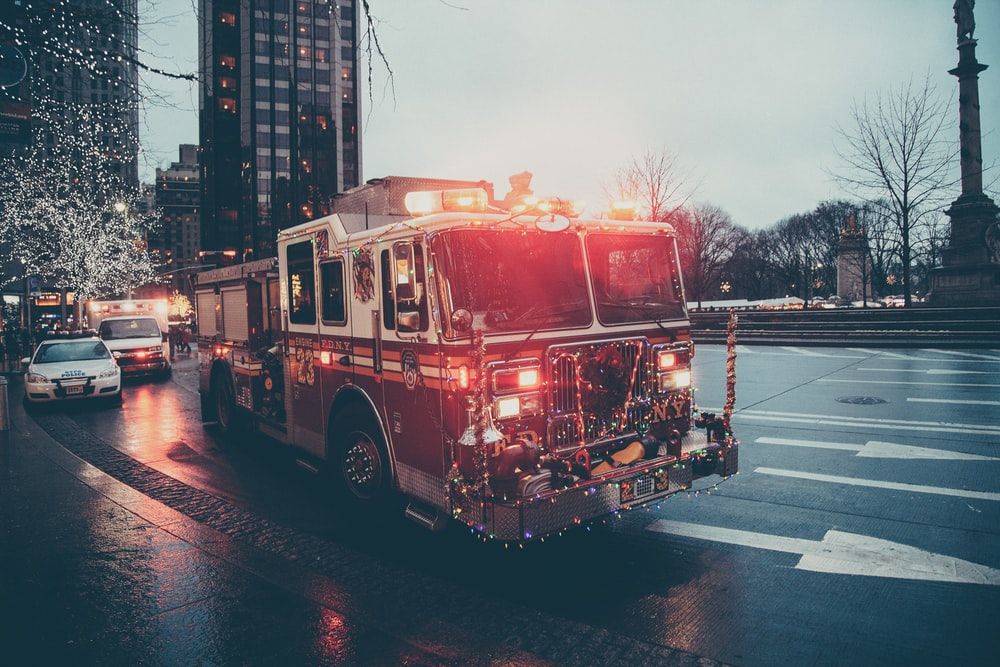 lighted fire truck near buildings