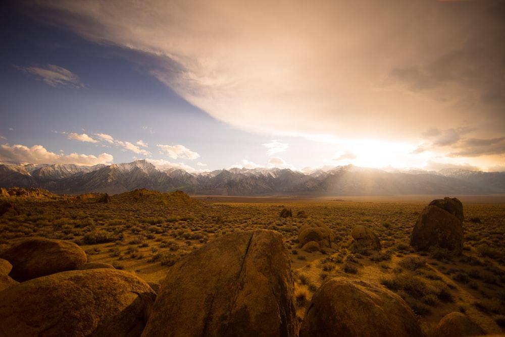 brown desert under cloudy sky
