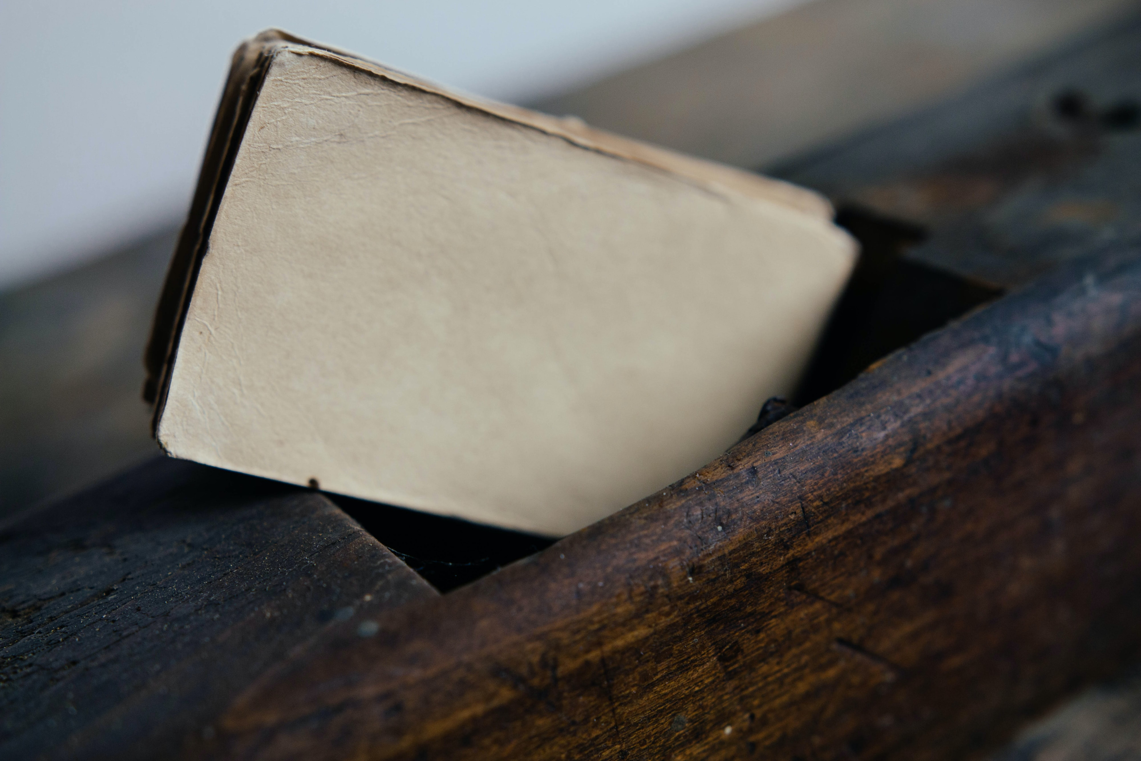 Old paper in a wooden box
