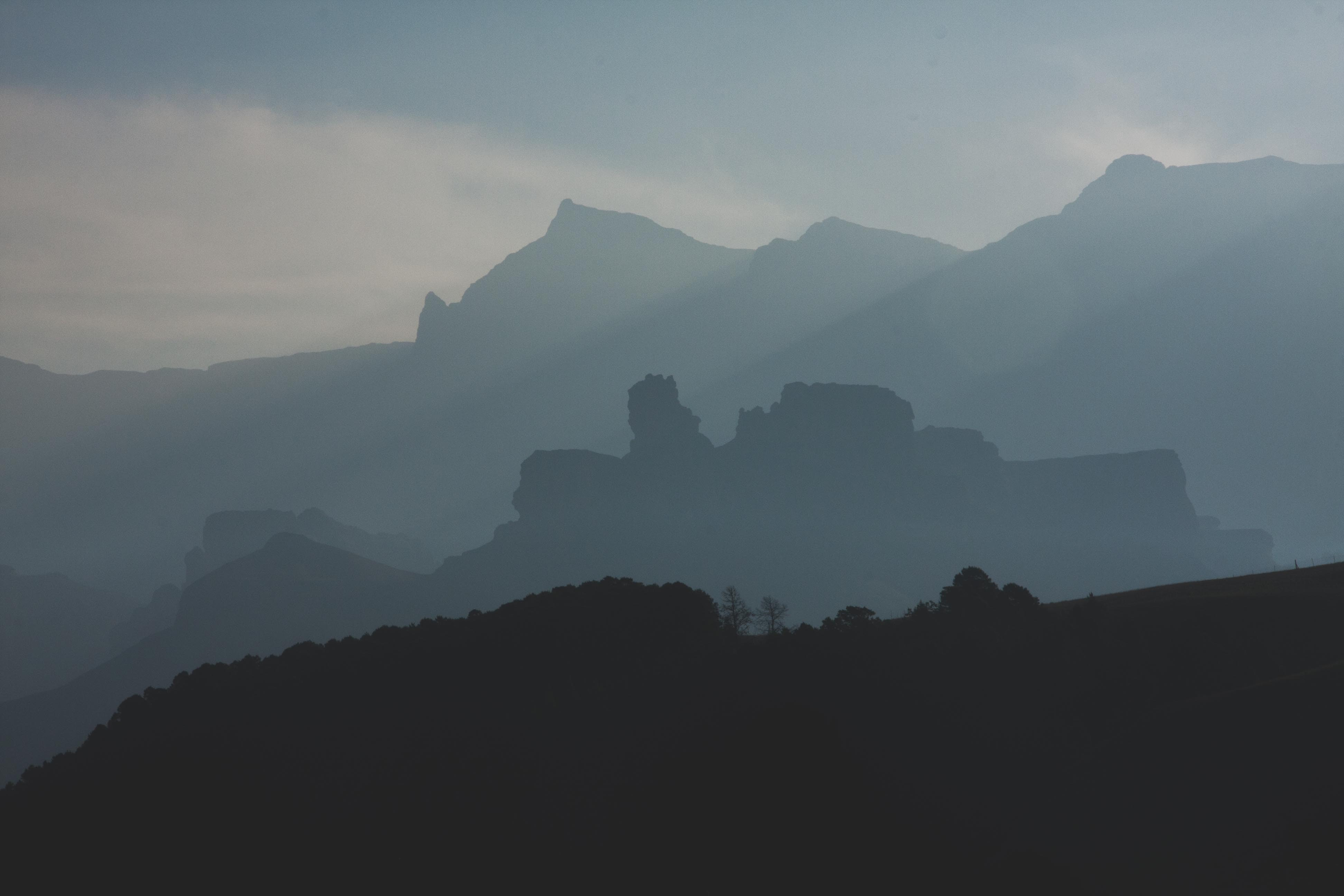 photo of foggy mountains during daytime