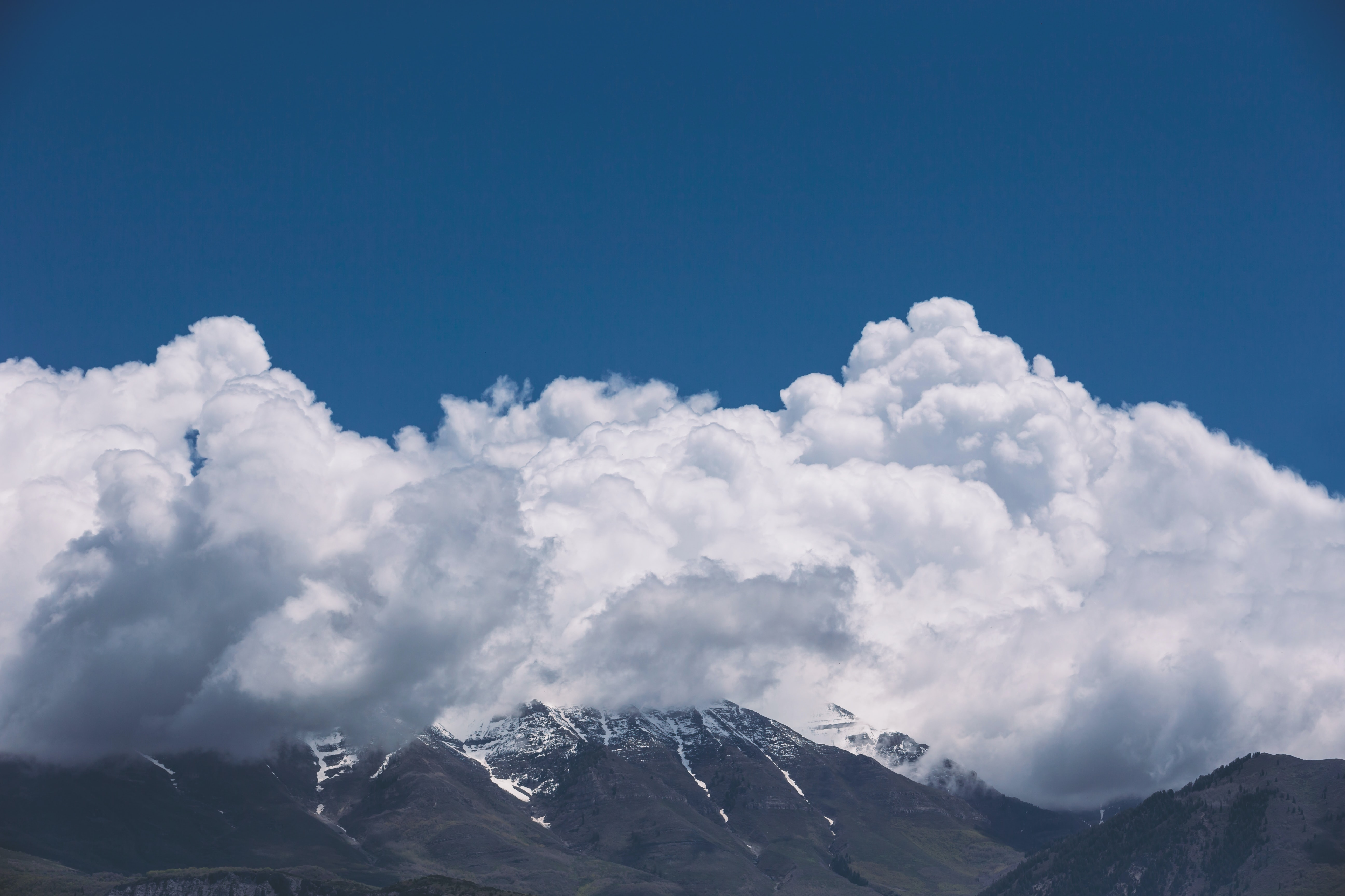 white clouds in top of mountain