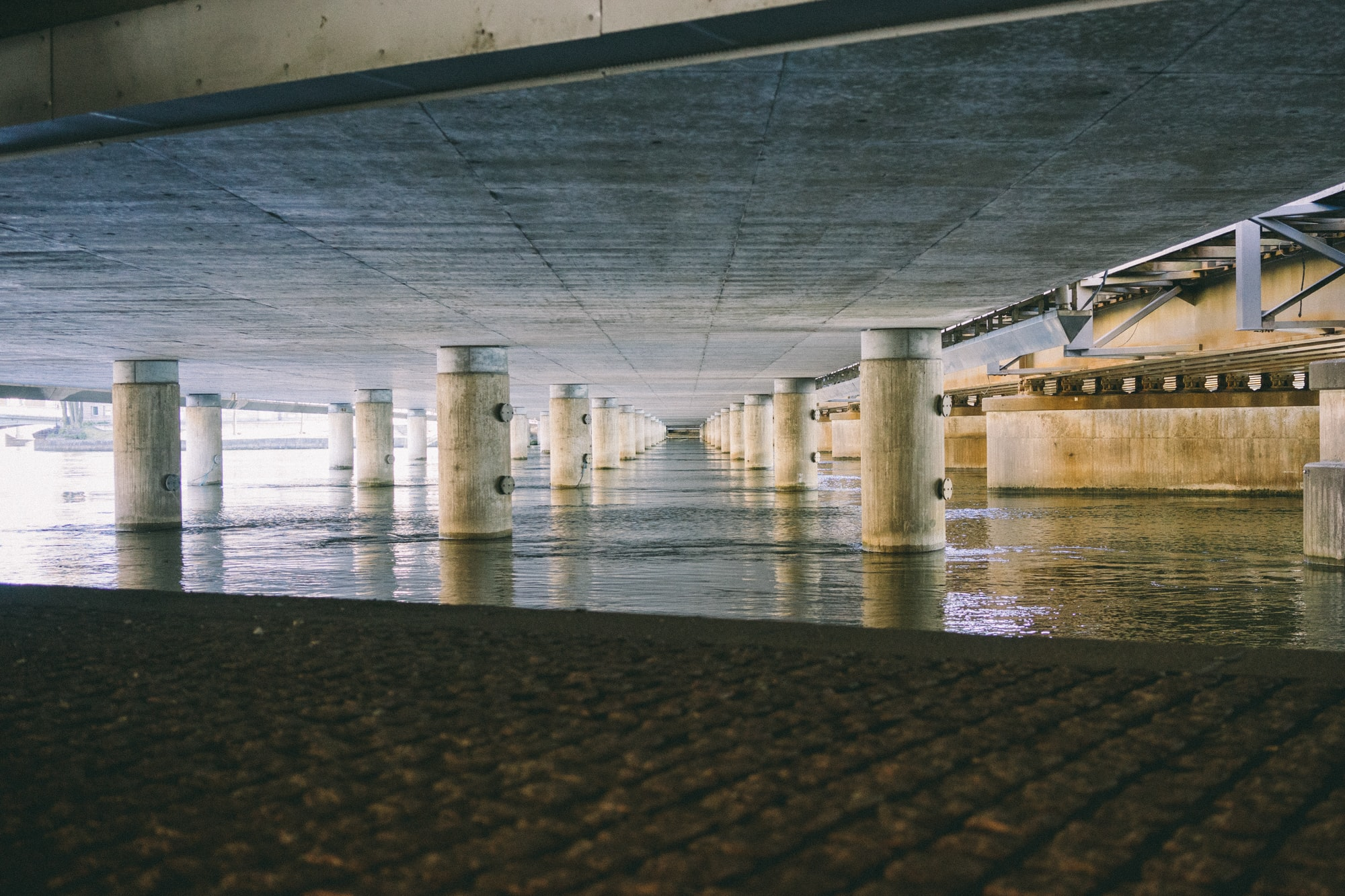 Underground abandoned car park with cement pillars and stylish architecture