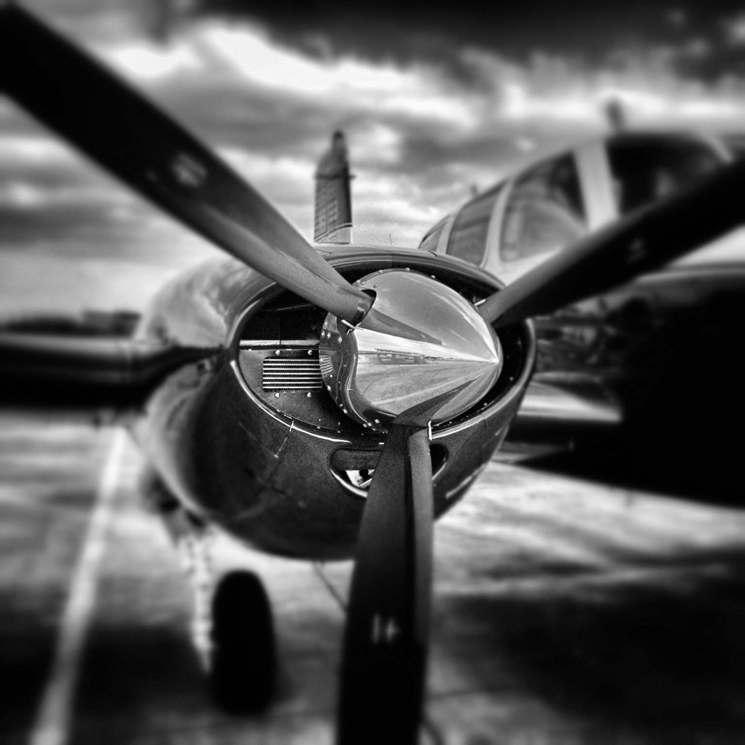 Black and white macro shot of airplane propeller with reflection