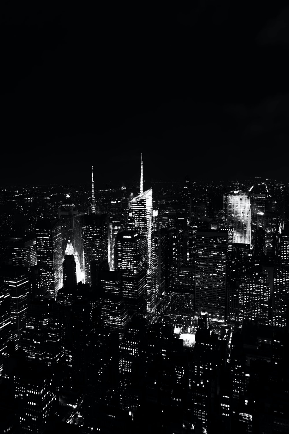A Black And White Photograph Of Cityscape With Urban Skyscrapers