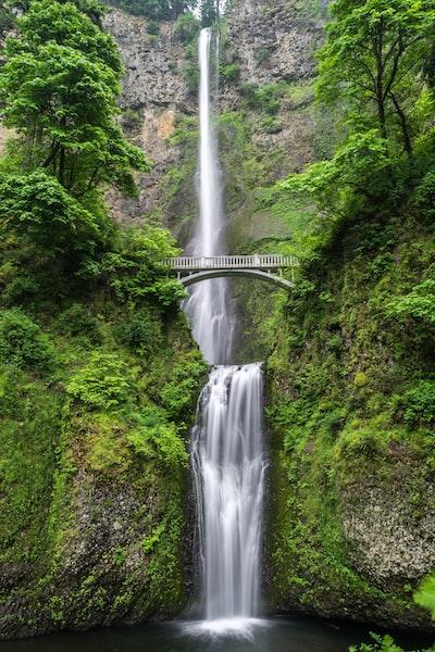 Bridge over a green waterfall