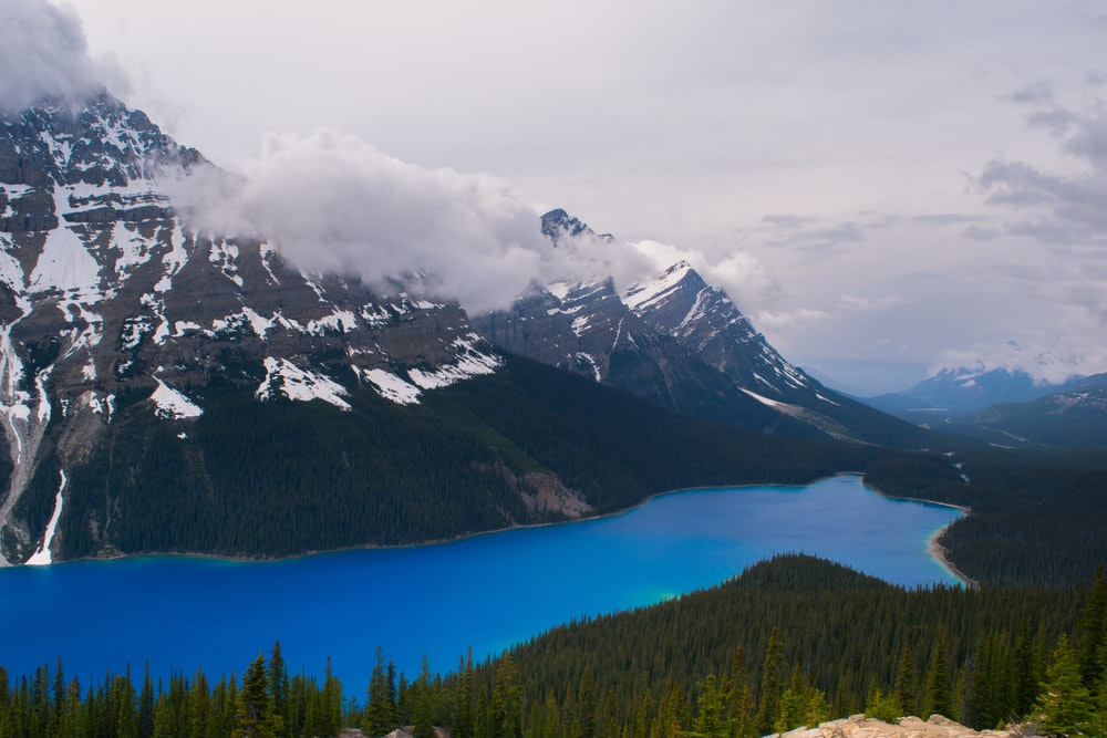 landscape photography of lake and mountain canyon