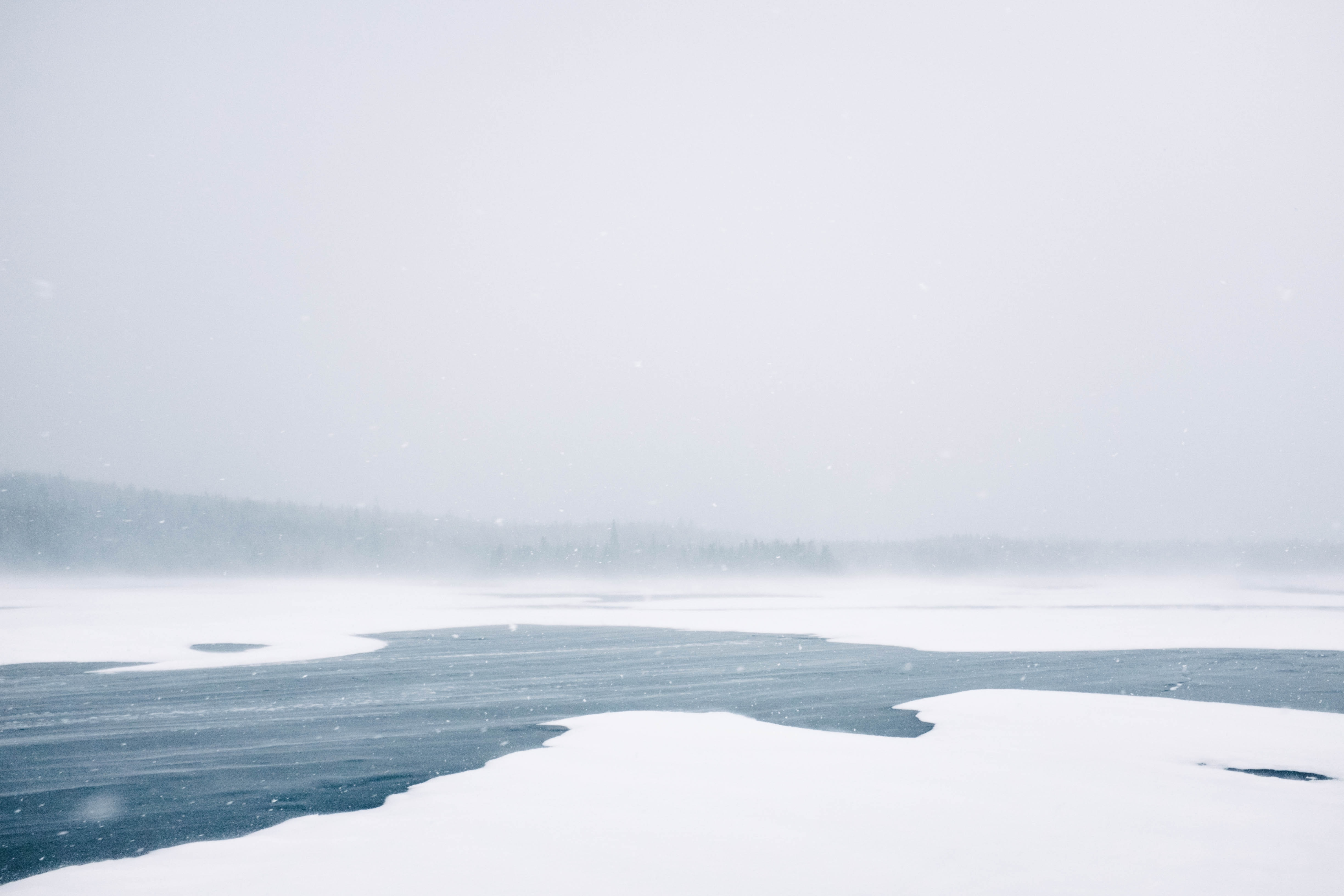 Snow covered lake during a blizzard with frozen water throughout