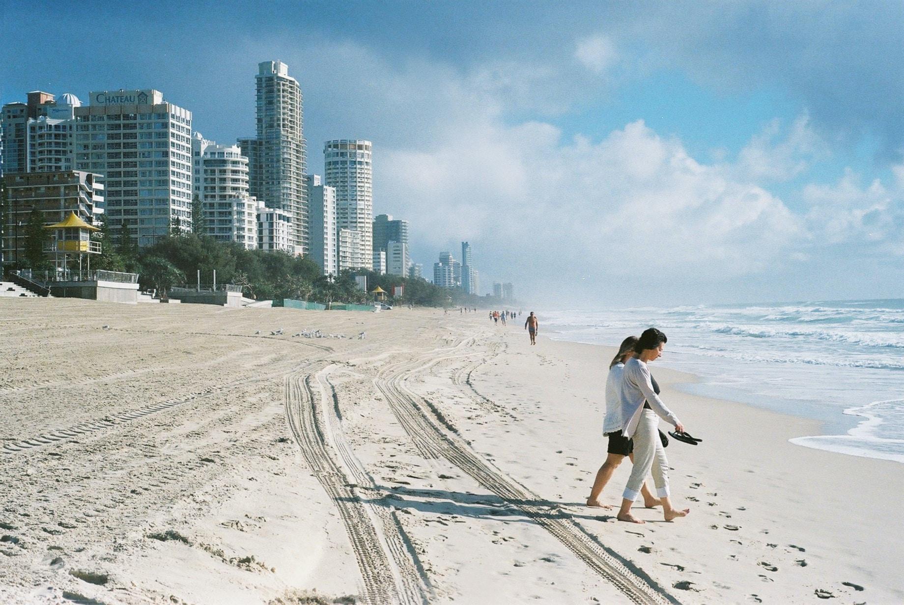 People on a city sand coastline at Surfers Paradise