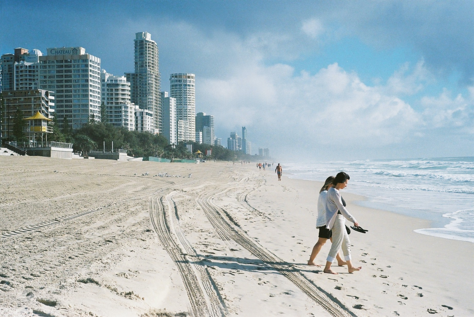 People on a city sand coastline at Surfers Paradise