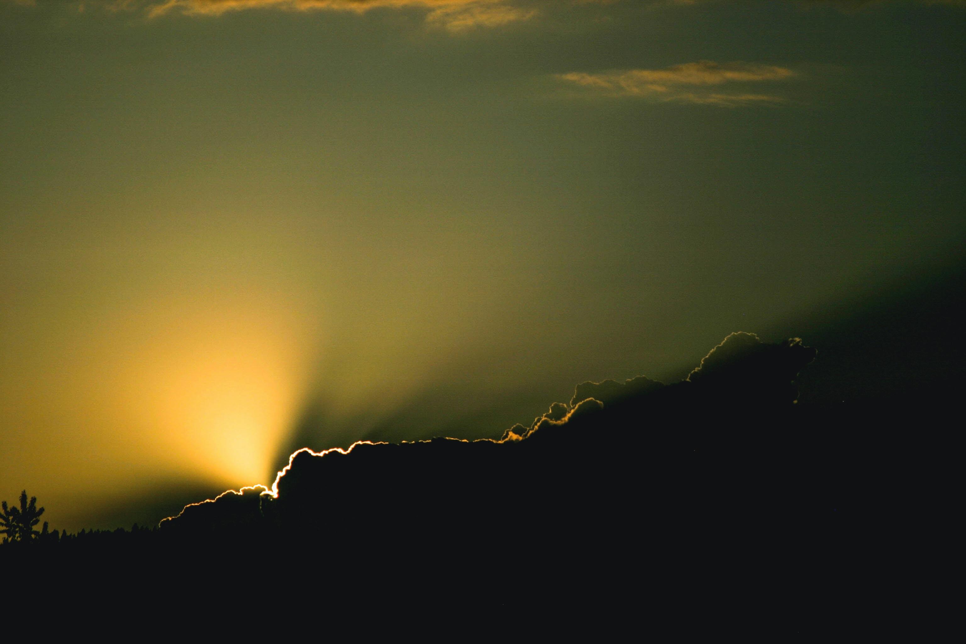sunshine through clouds during sunset