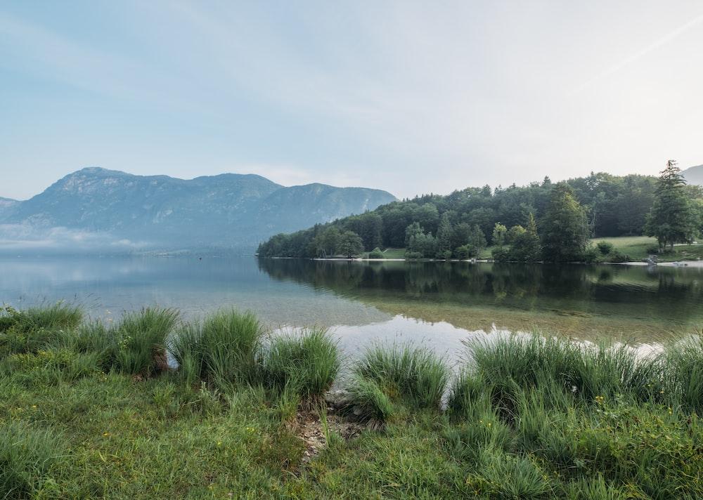 photo of lake across mountain during daytime