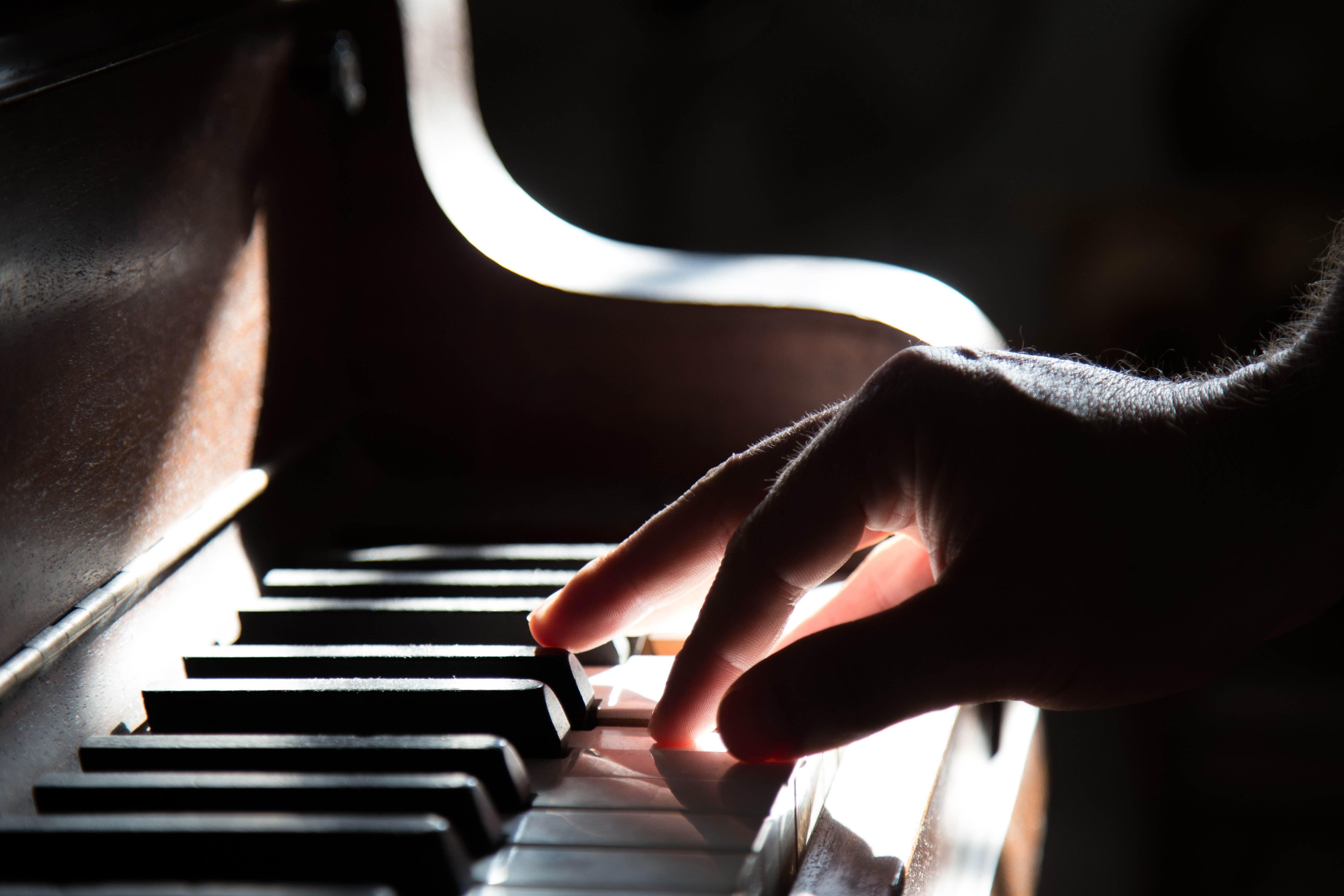 A person playing the piano in the light
