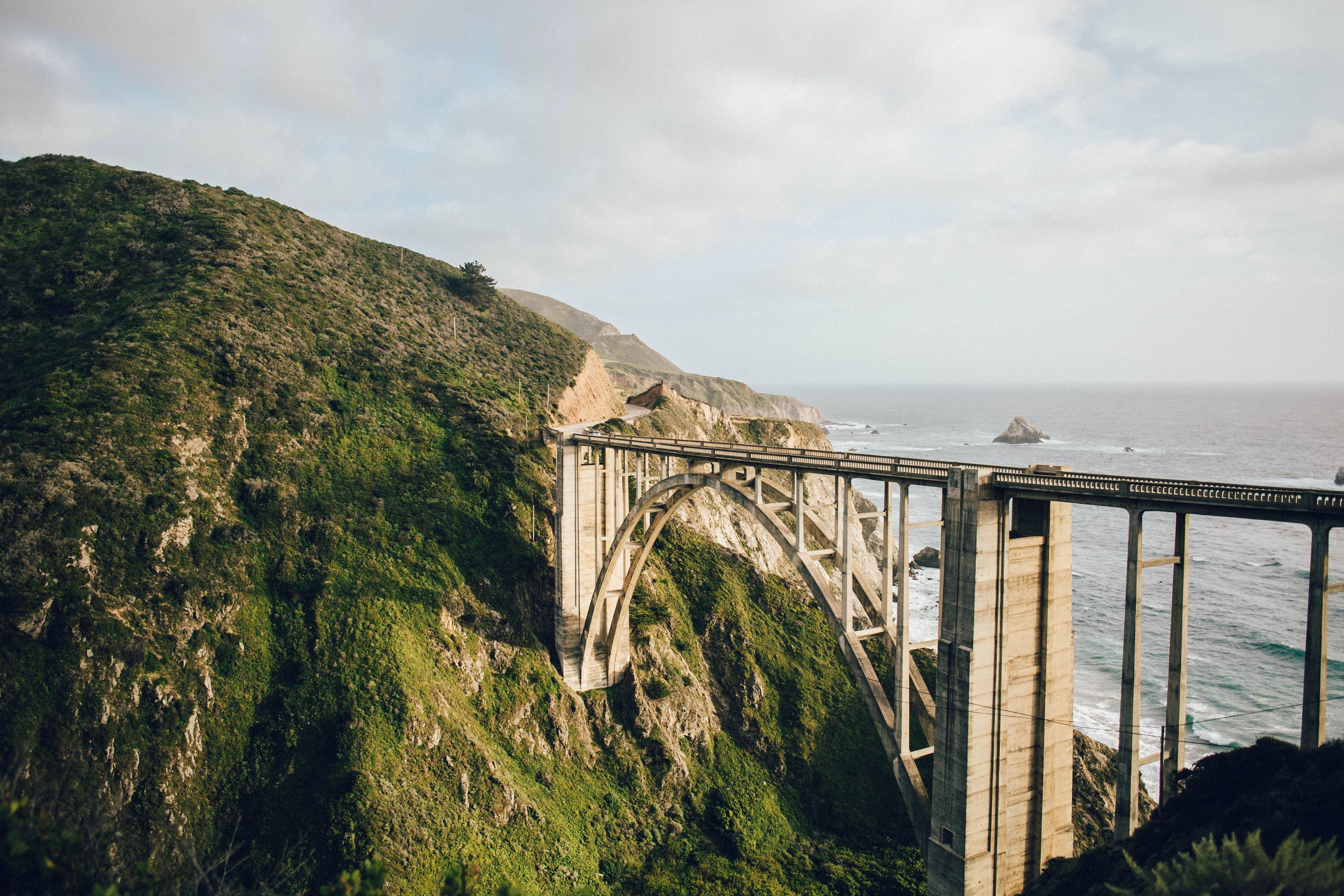 photography of bridge on mountain