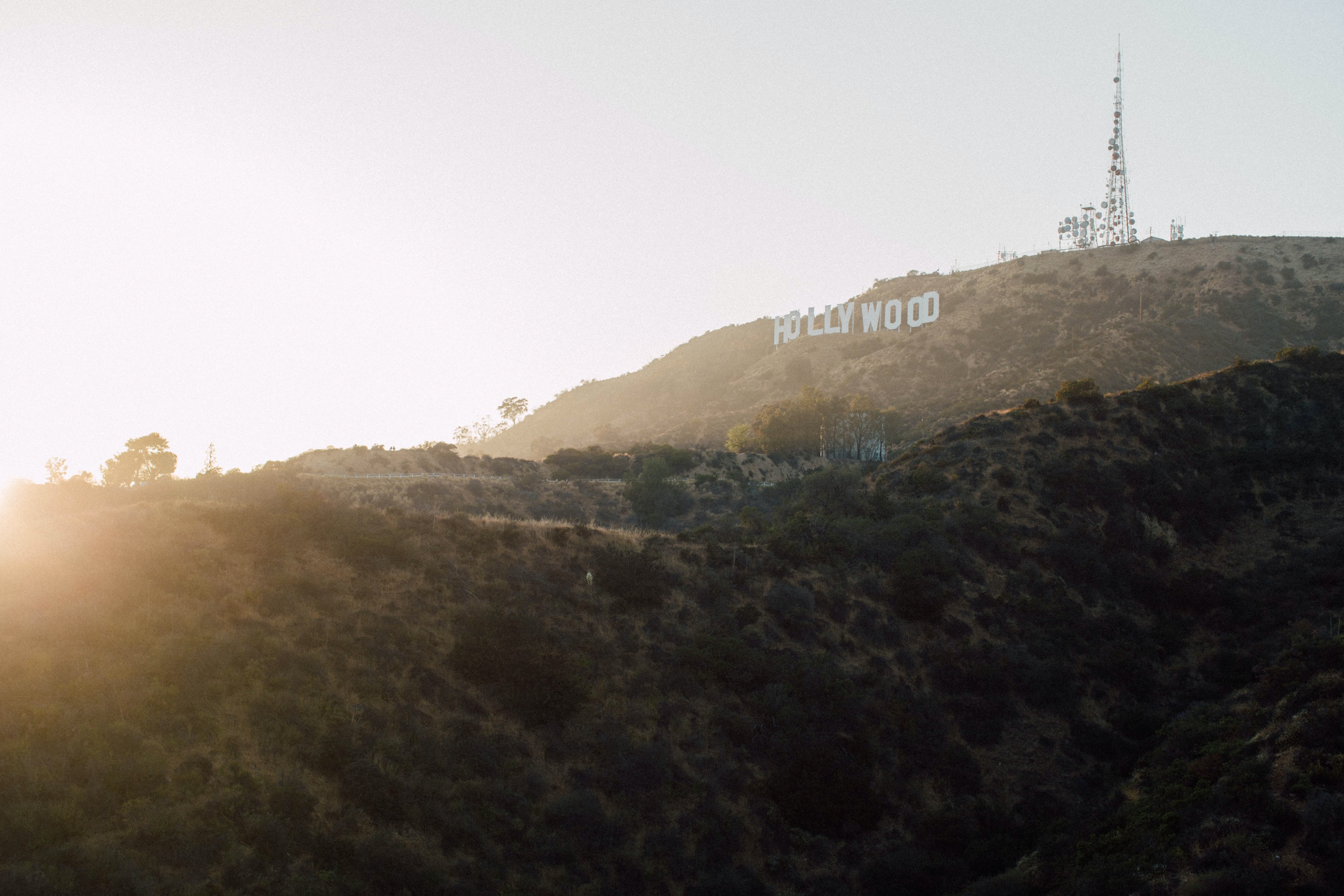 Sun shine on the Hollywood sign near a hillside in L.A.