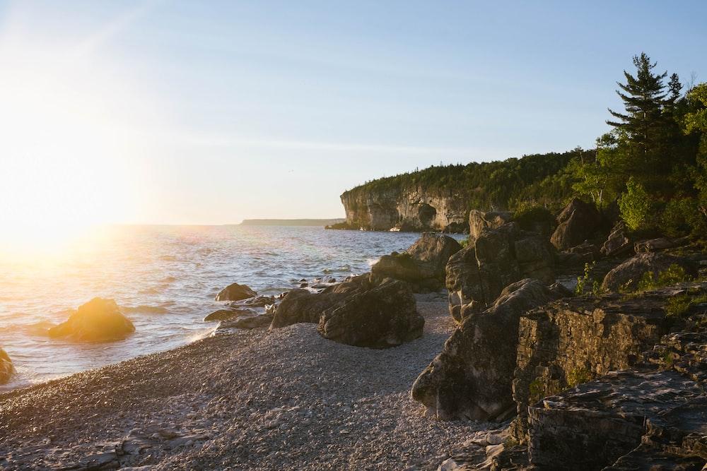 landscape photography of white sand rocky beach
