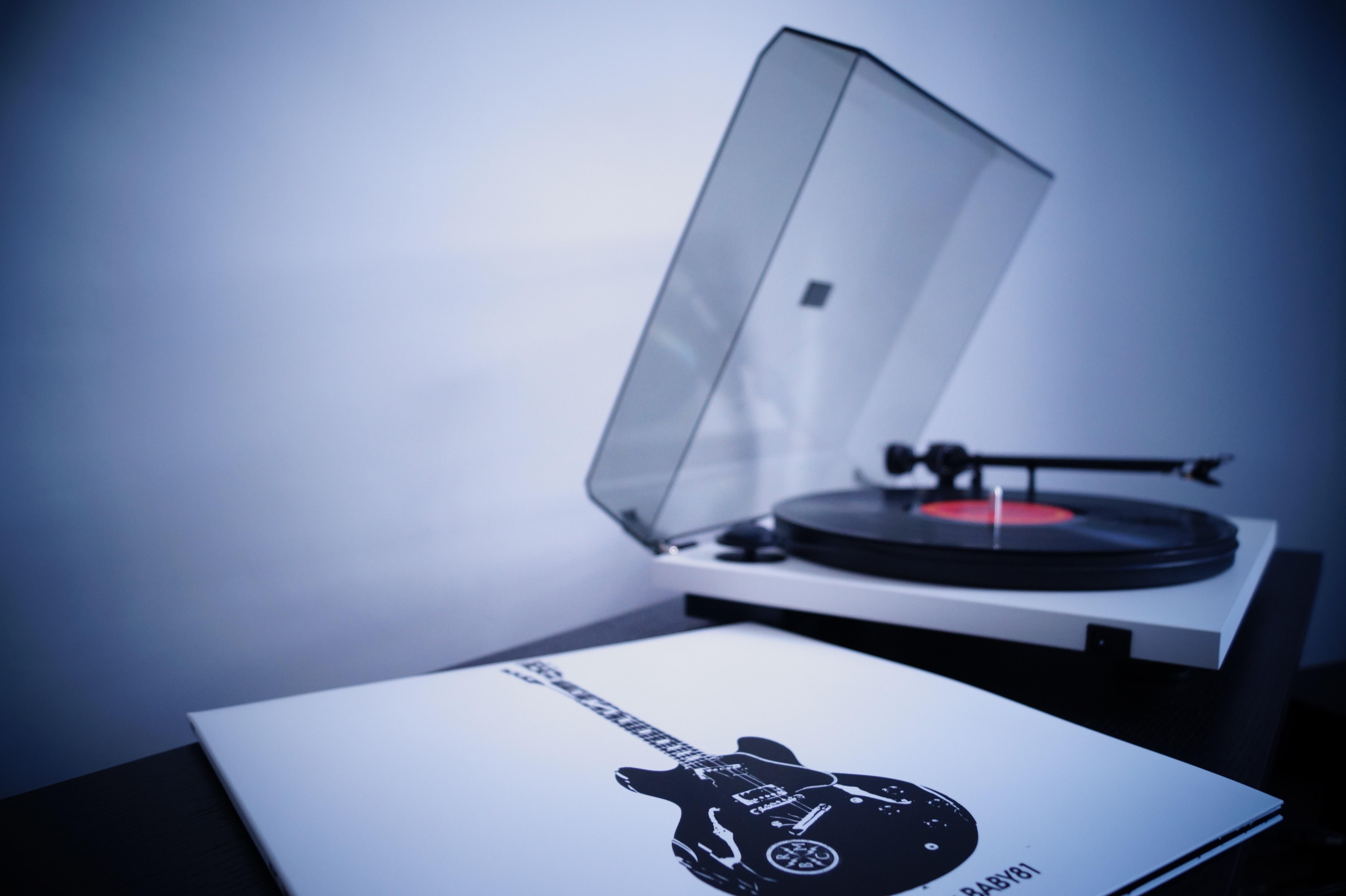 white and black vinyl turntable