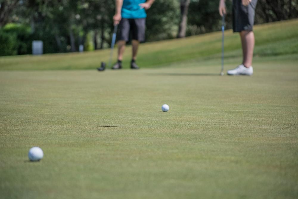 shallow focus photography of golf balls