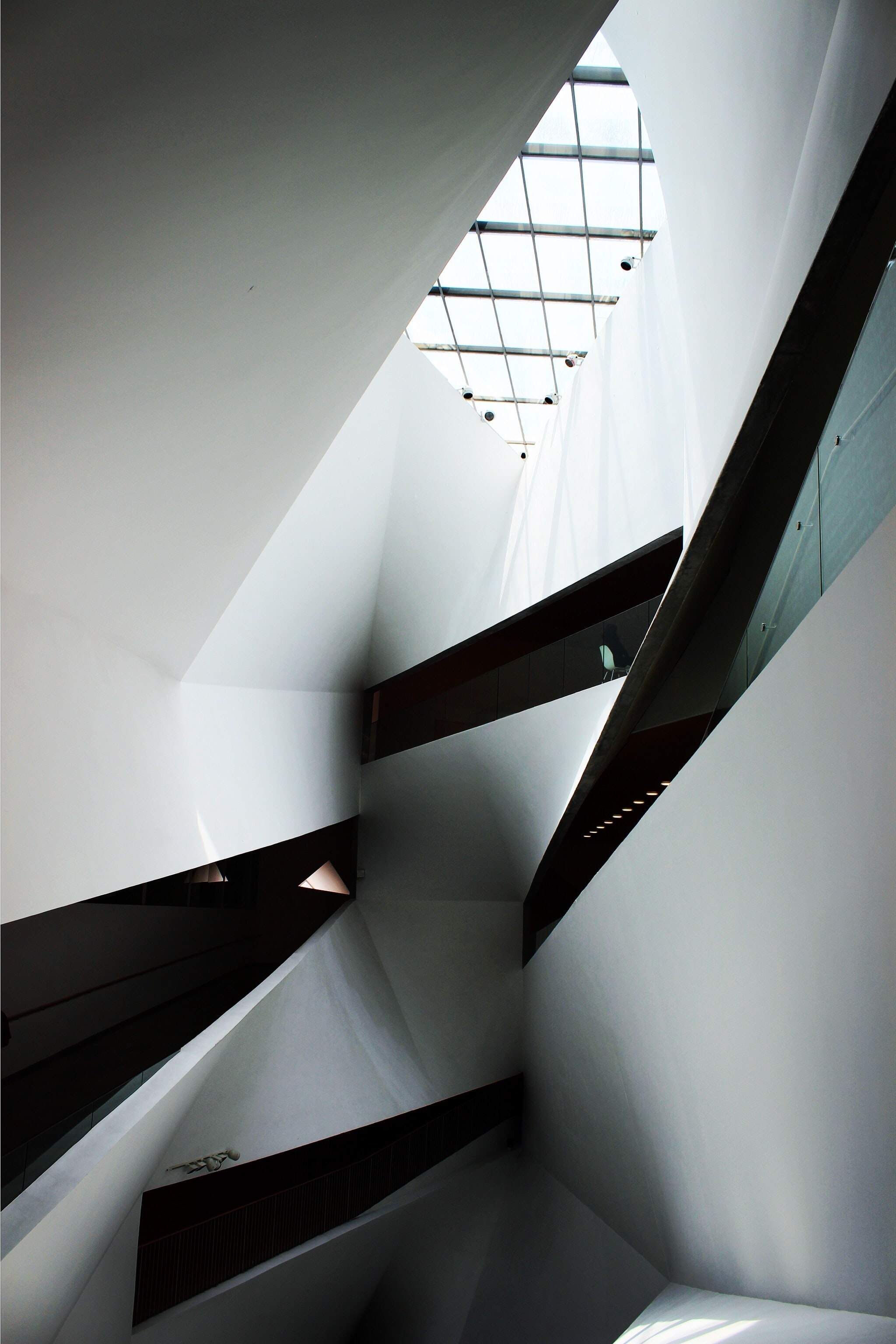 The inside of a black and white building with a unique architectural design