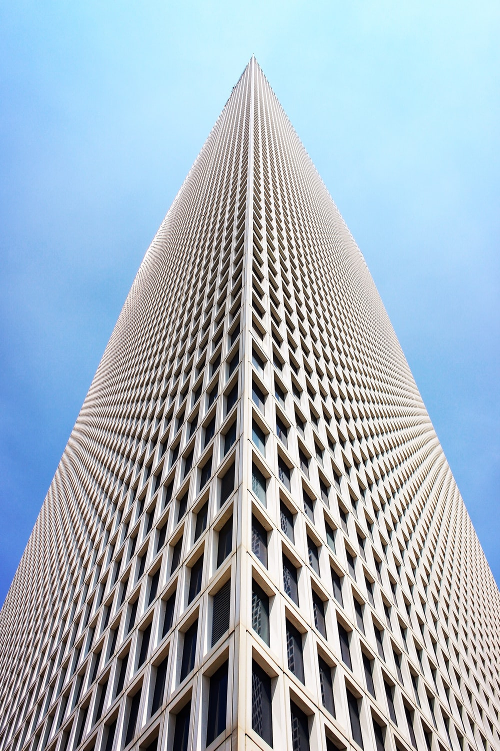 architectural and low-angle photo of white high rise building