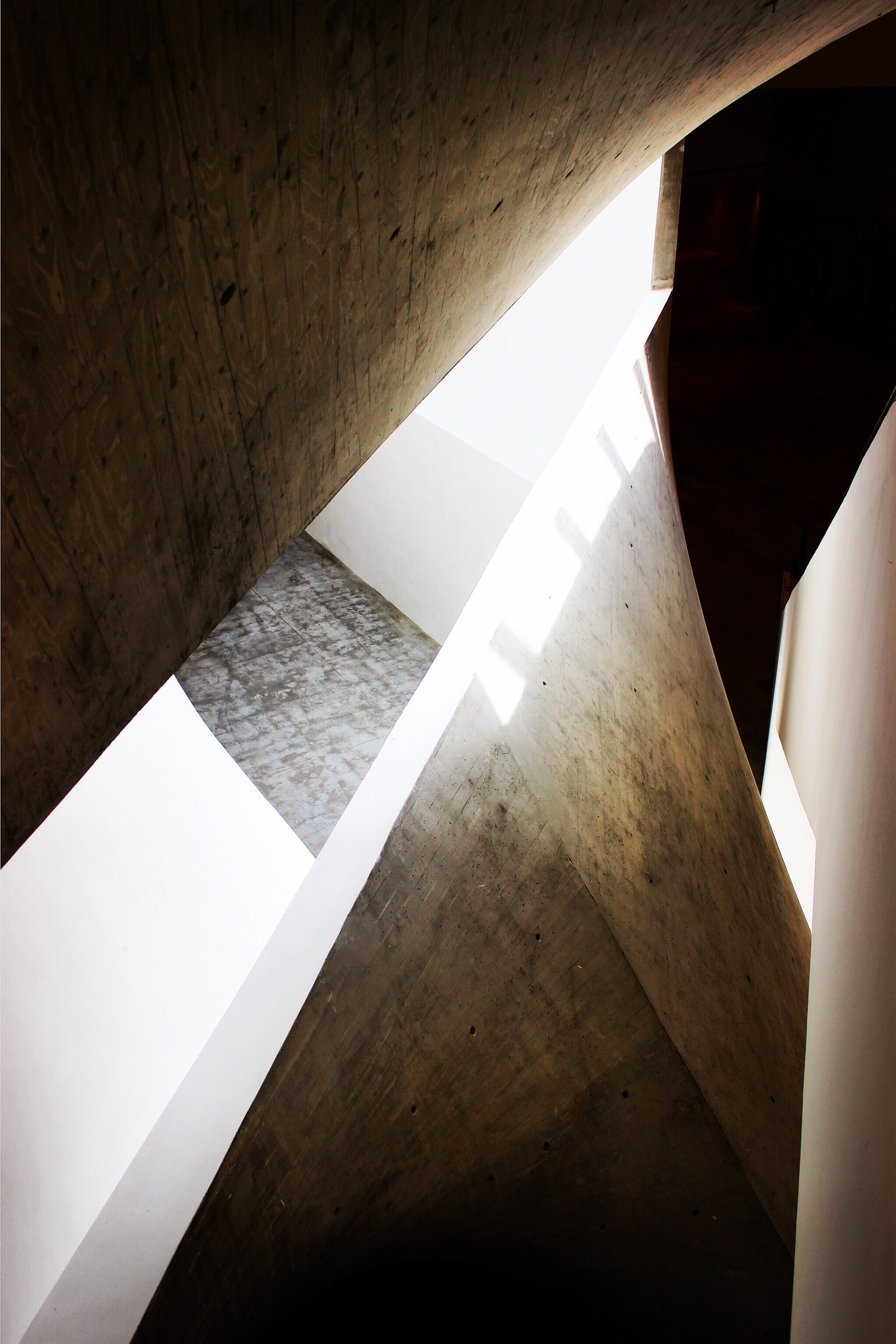 Edges of rocky architectural walls and designs reflecting light and casing shadows