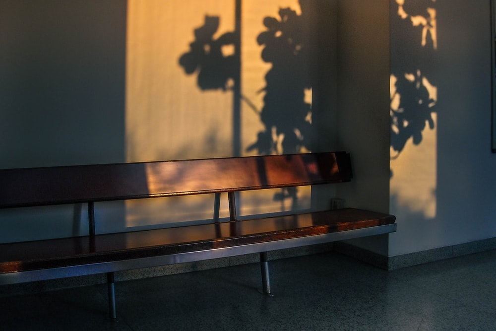 vacant brown wooden bench