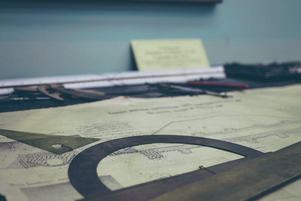 beam design-printed paper on desk