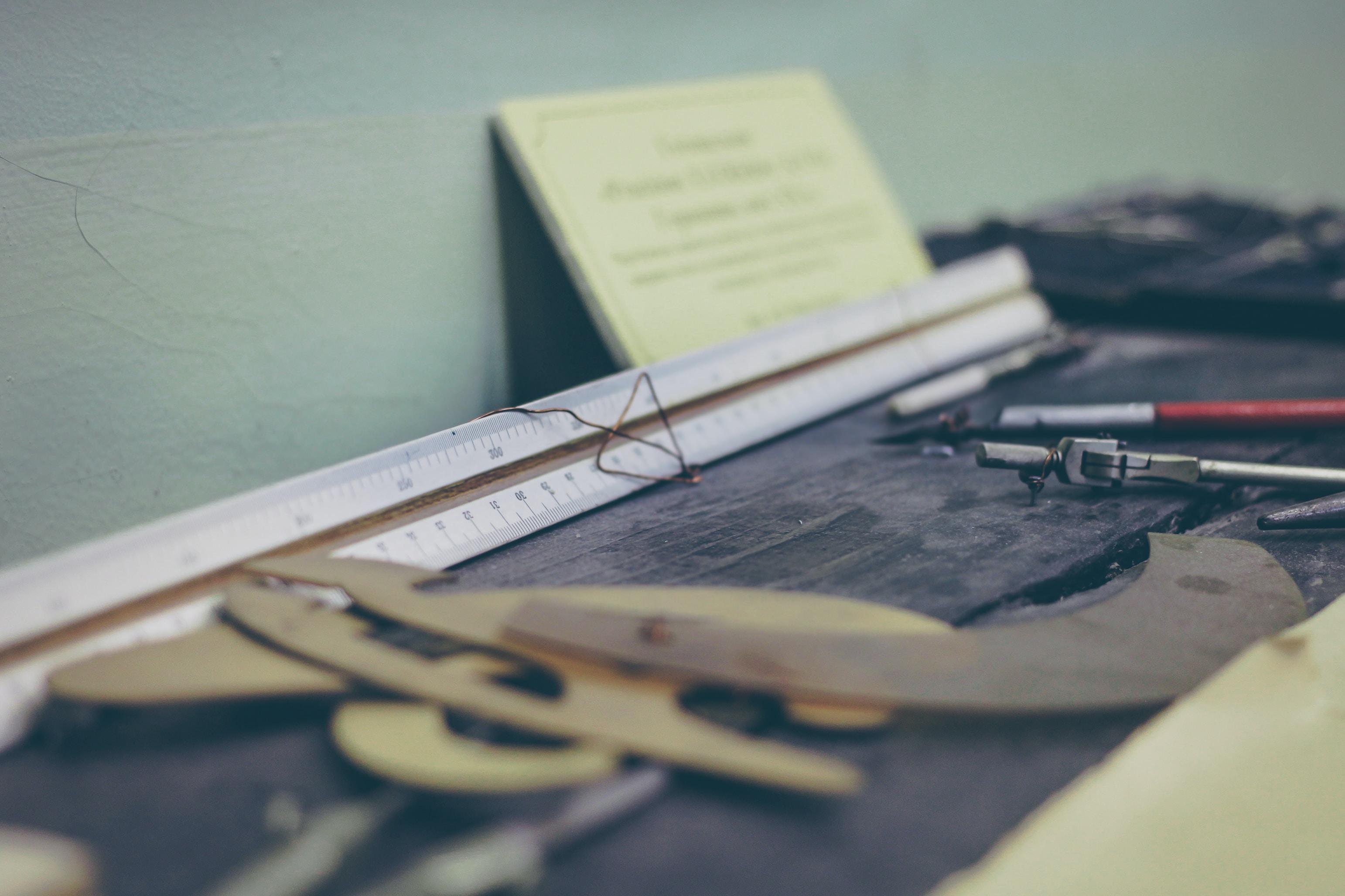 white ruler on desk