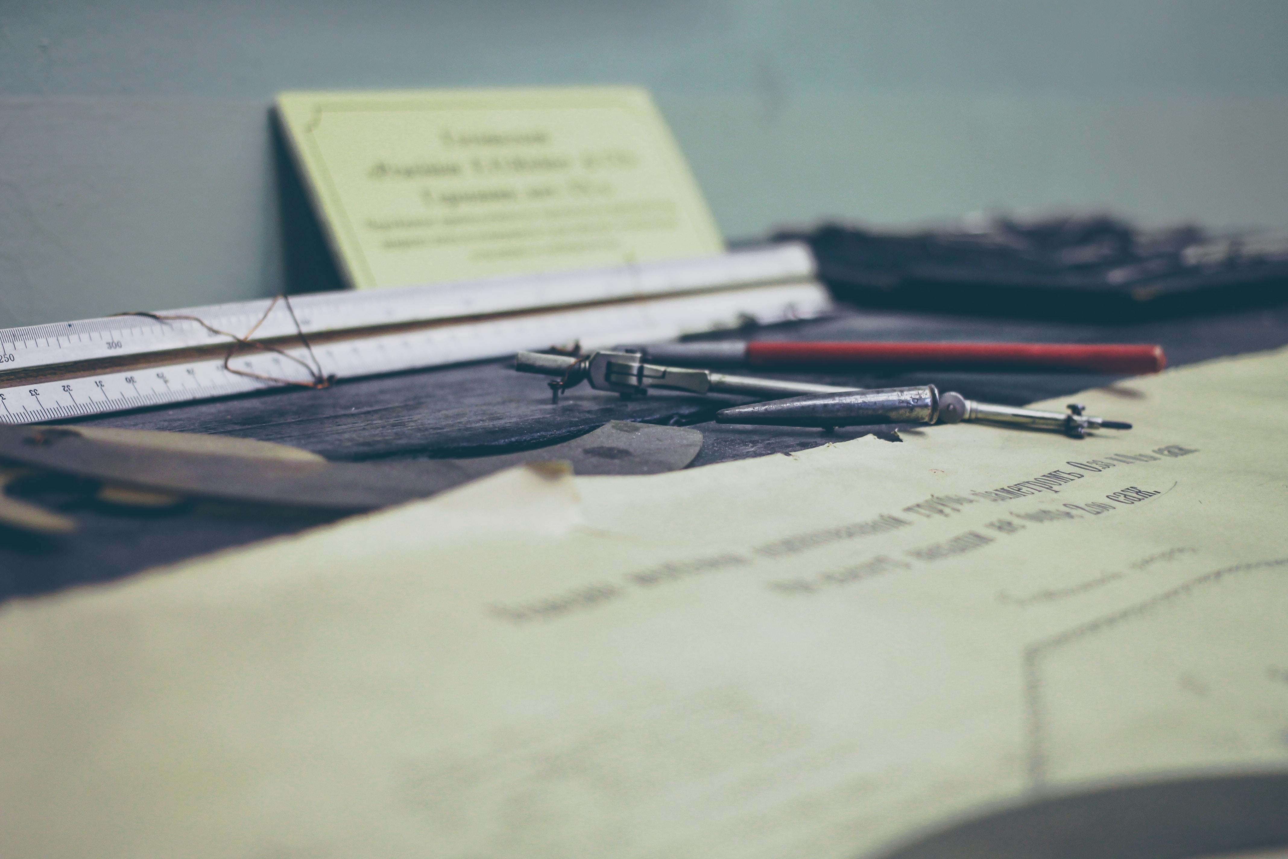 gray compass tool on table