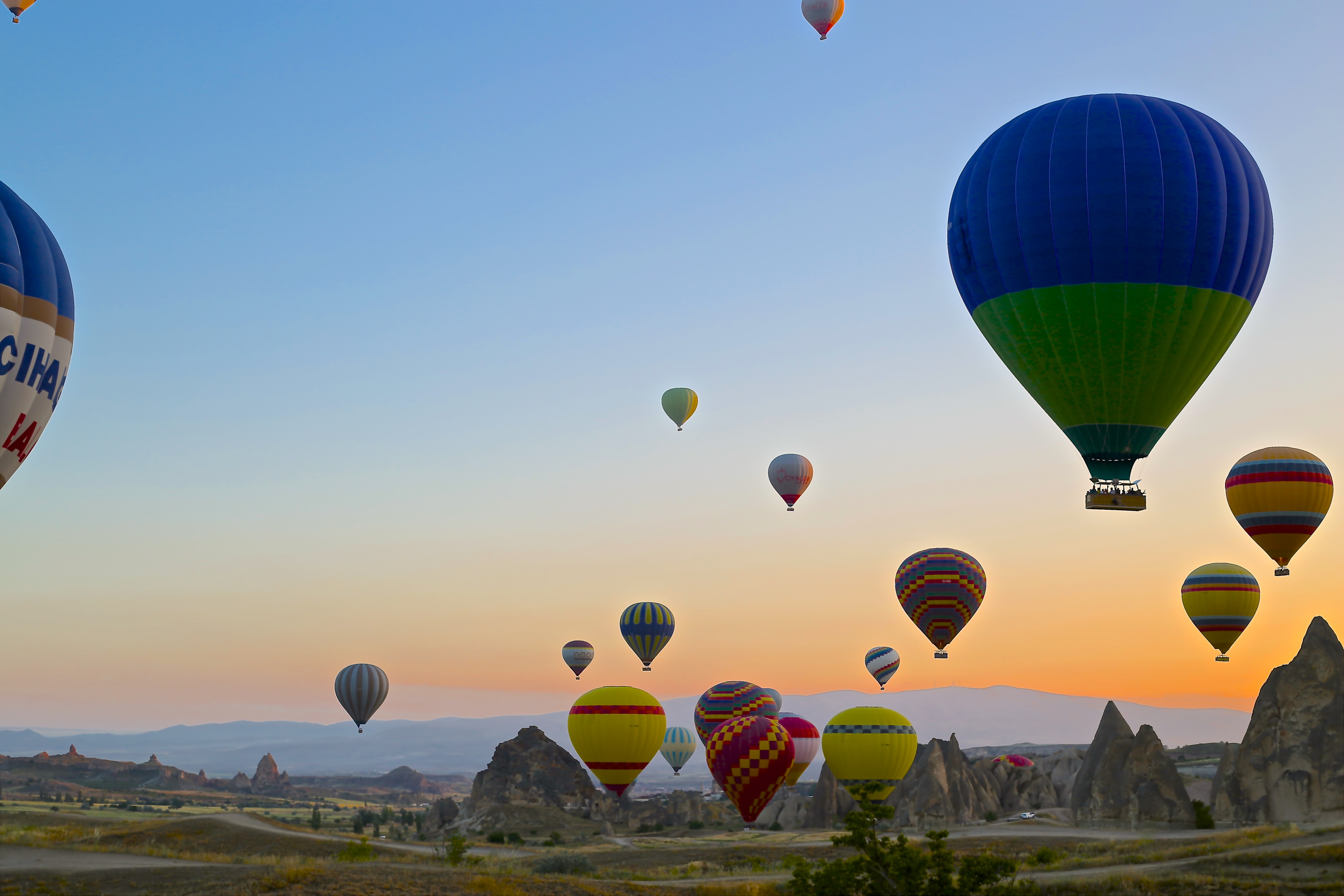 assorted-color hot air balloons in clear blue sky
