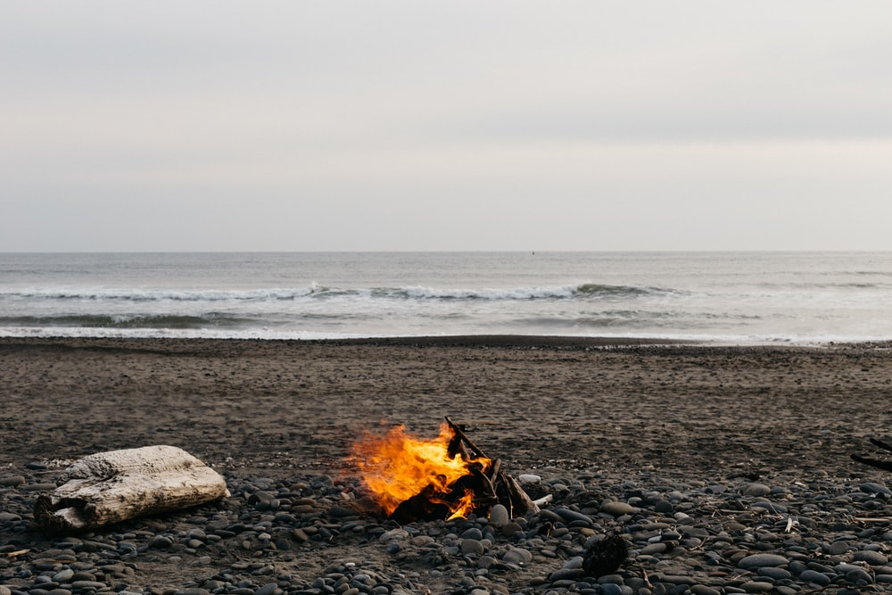 bonfire on beach during daytime