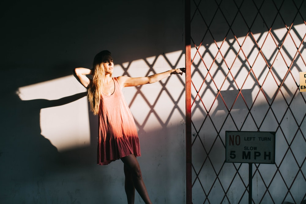 woman holding red steel gate